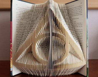 Deathly hallows symbol folded into Harry potter and the deathly Hallows