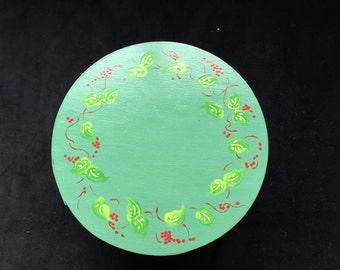 Round, green trinket box