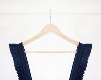 Knitted dark blue overall dress with pleats