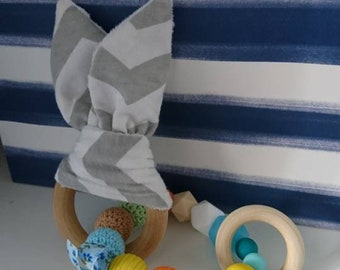 Teething ring with sensory material ears