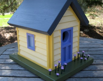 Cottage Birdhouse, with Siding and Purple Flowers