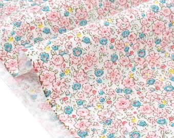Pink floral soft cotton twill fabric pale turquoise background ecru x50cm
