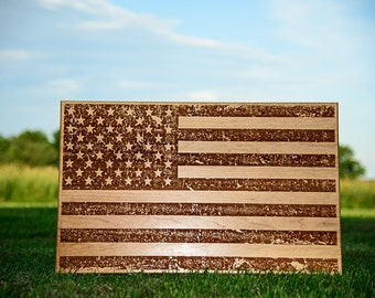Distressed American flag engraved on cherry wood.