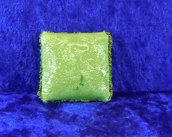Dollhouse Miniature accessory in twelfth scale or 1:12 scale; Decorative pillow.    Item #398.