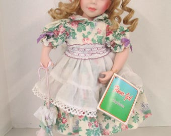 Vintage porcelain curly blond hair blue eyed 15 inch doll purple flowered  dress with parasol  Flower Girl Exclusive used