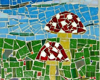 Handcrafted fly agaric mushroom mosaic, set against blue sky