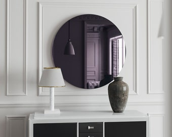 Decorative wall mirror. Round Mirror. 1950s inspired purple glass mirror with MidCentury style. Modern design for a stylish living space.
