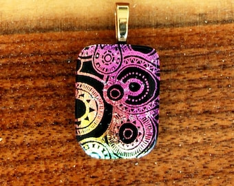 Gold and pink dichroic Steampunk gears glass pendant