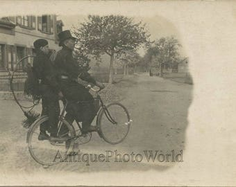 Father and son chimney cleaners w tools on bicycle antique private rppc photo