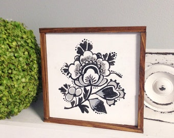 farmhouse style sign with a delft design in black and white