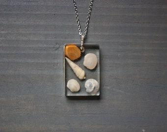 Tiny sea shell resin necklace