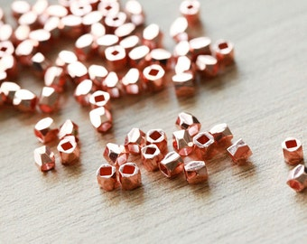 50 pcs of faceted solid metal Rose Gold nugget beads - lovely sparkling gold , 3mm