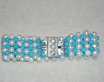 A cute blue and white plastic beaded bracelet.