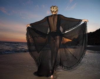 black butterfly silk dress with bodysuit .By Stella Dottir