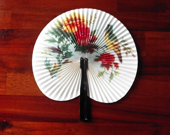 Vintage Chinese Fan - Paper and metal with printed design of a bird and flowers on a pale background.