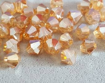Crystal bicones, gold bicone Crystal beads, pearls-Marie 50 4 mm bicone 4 mm Golden champagne peach Swarovski Crystal bicones