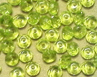Faceted lemon-lime glass beads; very pretty, faceted lemon-lime glass rondelles, 4x6mm, 20pcs/1.80.