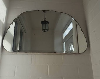 Vintage mirror cloud or bubble shaped mid century frameless mirror with chain and wooden back. Heavy unusal shaped mirror very unique.