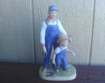 Delightful  Figurine of A Father and Son  Playing Horseshoes, Denim Days.