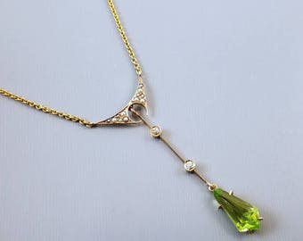 Antique Art Deco 10K gold kite shaped green peridot diamond and seed pearl long drop lavalier pendant necklace