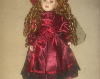 """Vintage doll, 80's doll, Broadway Collection doll, 16"""" doll, porcelain and cotton body, wine colored costume, COA."""