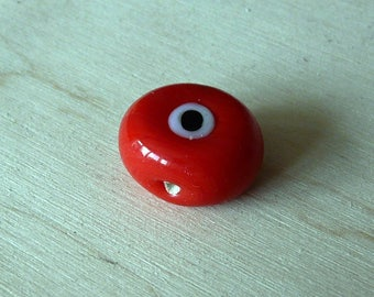 Red with black and white pattern ceramic bead
