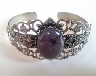 Antique bronze filigree bracelet with Amethyst cabochon