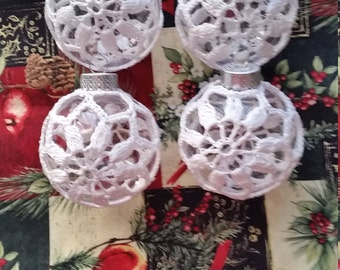 Clear Christmas balls and white or red crochet cover