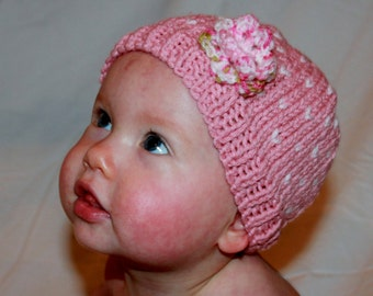 child's pink strawberry hat with flower