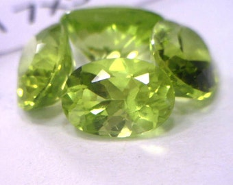 One Lettuce Green Peridot Gem 7x5 mm Oval Well Faceted Averages .93 carat each