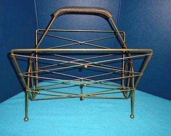 Mid century magazine rack. Magazine rack. Mid century brass magazine rack. Mid century brass. atomic era. atomic