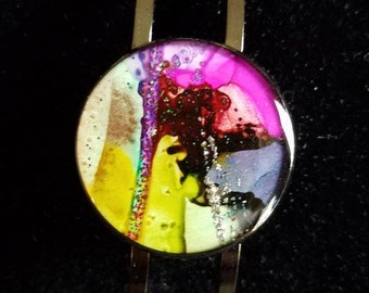 Round alcohol ink bracelet on shinny gun metal grey base. One of kind, can't be duplicated!!
