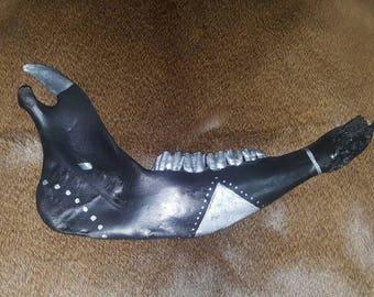 Black and silver tribal jaw bone