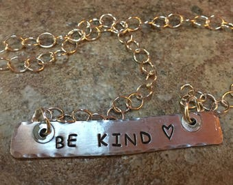 hand stamped and cut aluminum with hand stamped BE KIND