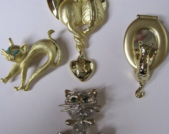 Three Vintage Cat Pins and One Contemporary Cat Pin