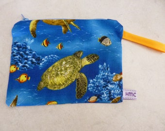 Small zippered bag. Australian Reef Turtles  print.  Yellow strap. approx 18cm x 13cm. Fully lined and washable.