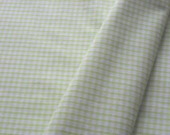 "a beautiful cut of cotton fabric ""light green gingham"""