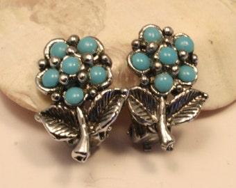 Vintage turquoise glass flower earrings. Clip on