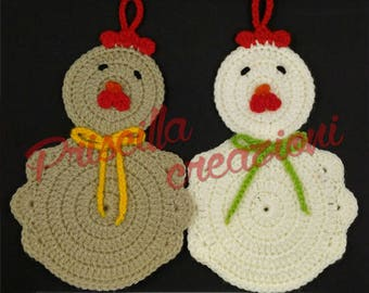 Pair of handmade pot holders made from crochet in the shape of a hen