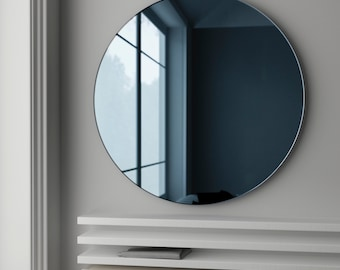 Blue glass mirror. MidCentury inspired wall mirror made with blue glass mirror. 1940s and 1950s hanging mirror.