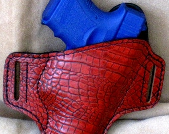 Handmade, antique red, gator print concealed carry holster.