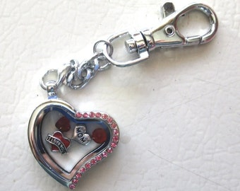 Heart Living Locket with pink rhinestones on one side with charms.