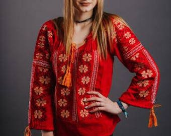 Women's  blouse with traditional embroidery