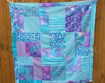 """Batik unfinished quilt top, approx 48"""" x 48"""". Turquoise and  lavenders."""