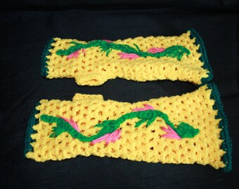 Yellow fingerless gloves crocheted with embroidery flowers