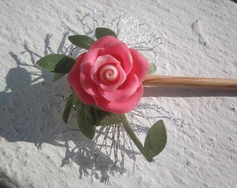 Mixed creation... A stick decorated with a rose on the reverse of your jacket or in your hair...