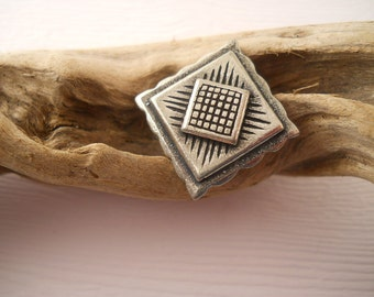 BUTTONS:  Unusual square metal button, 3/4 inch size, detailed surface.