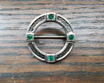 Beautiful sterling silver Celtic in with green stones