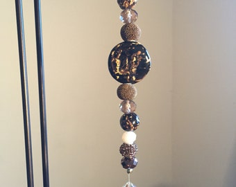 Brown and gold crystal suncatcher
