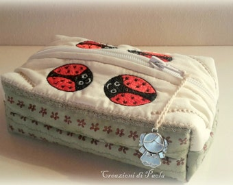 Fabric case with embroidered ladybugs